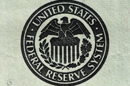 A close up of the Federal Reserve System logo on a $100 bill pictured on October 31, 2014. The United States Federal Reserve announced last Wednesday that it would end its policy of quantitative easing that was put in place in 2008 with the hope of stimulating the economy. (Photo by: Alex Milan Tracy/Sipa USA)